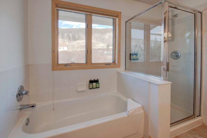 Unit 190: Private Bath for Bedroom 1. Greenbelt view.