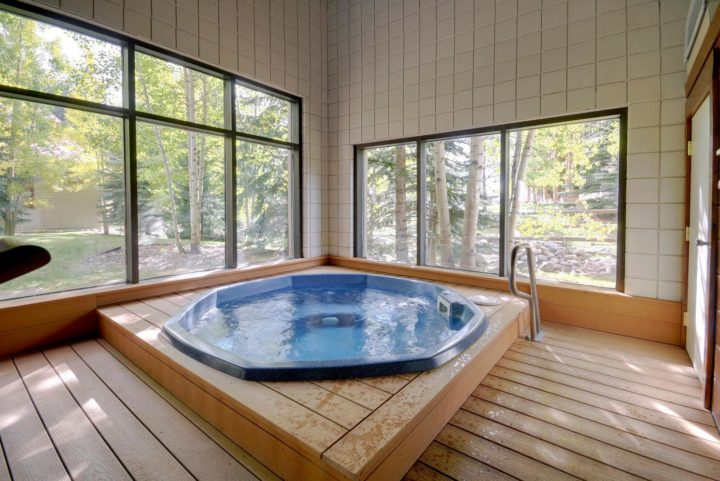 Clubhouse on site with heated pool, hot tub, and steam room.