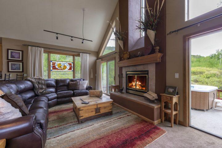 Living room has 3 walls of windows