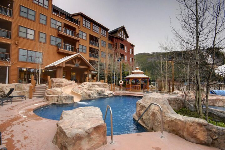 Heated outdoor pool with water slide