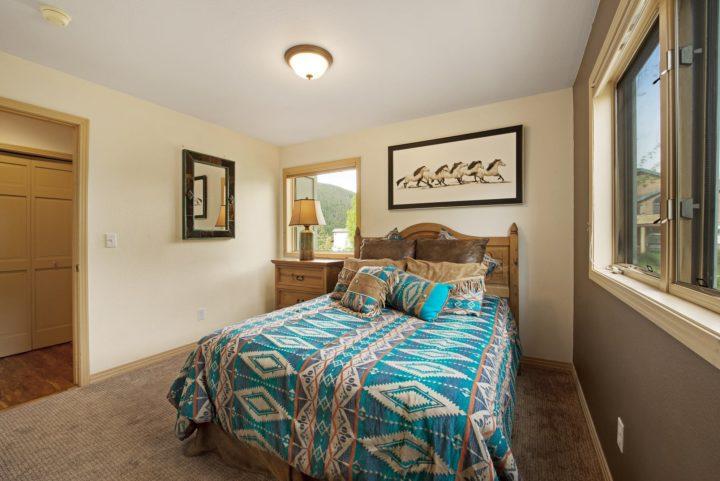 Bedroom 2--Queen bed; hall bath