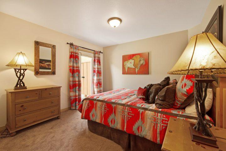 Bedroom 3 (Queen bed). Door to patio.
