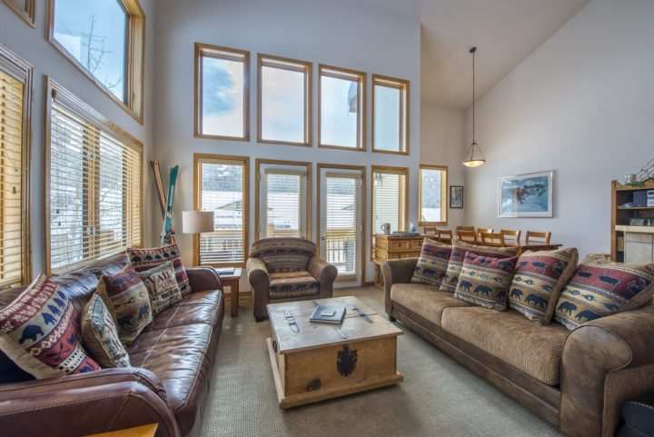 Living room has patio door to private deck facing the ski runs