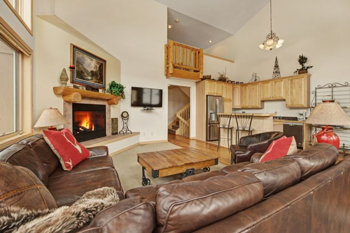 Living room has fireplace and flat screen TV