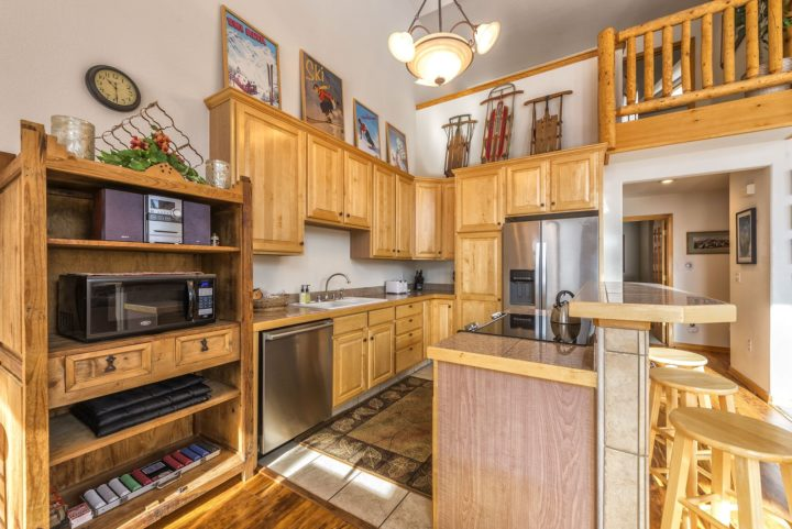 BOTH duplex kitchens have new stainless steel appliances.