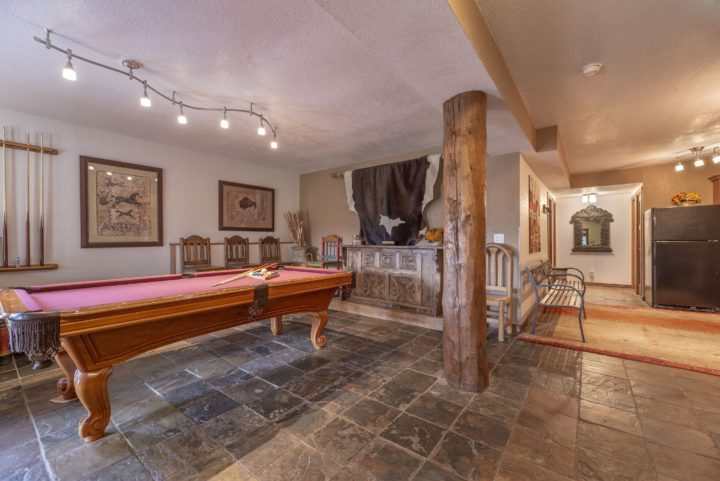 Lower Level entryway, game room, and kitchen