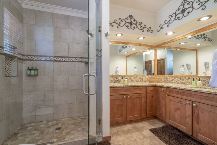 Private bath for Bedroom 4 (double sinks, granite counters, glass walk-in shower)