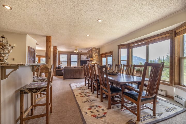 Dining room and kitchen area have the same mile-wide views as rest of house.