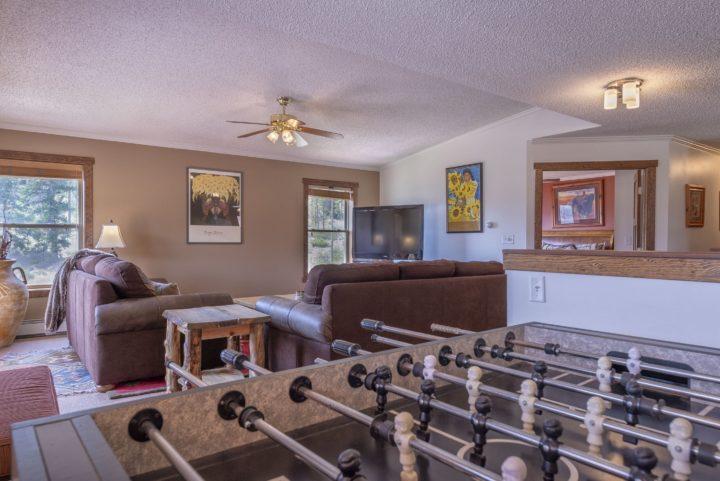Foosball table in upper level living room.