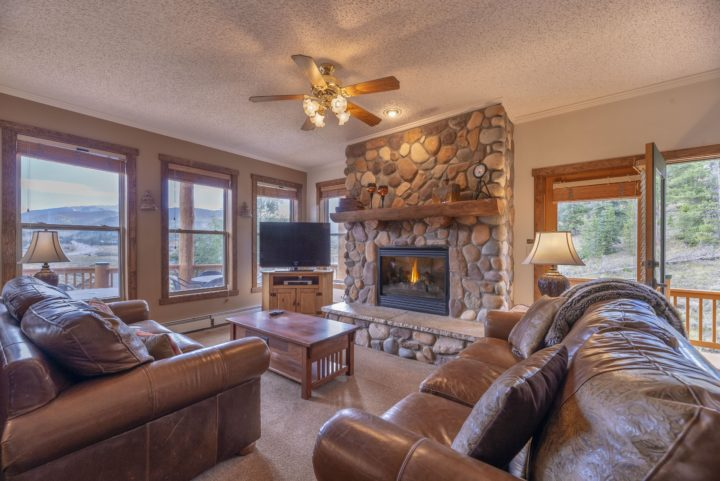 Main living area--stone fireplace, flat screen 1 (HDTV), Queen fold out.