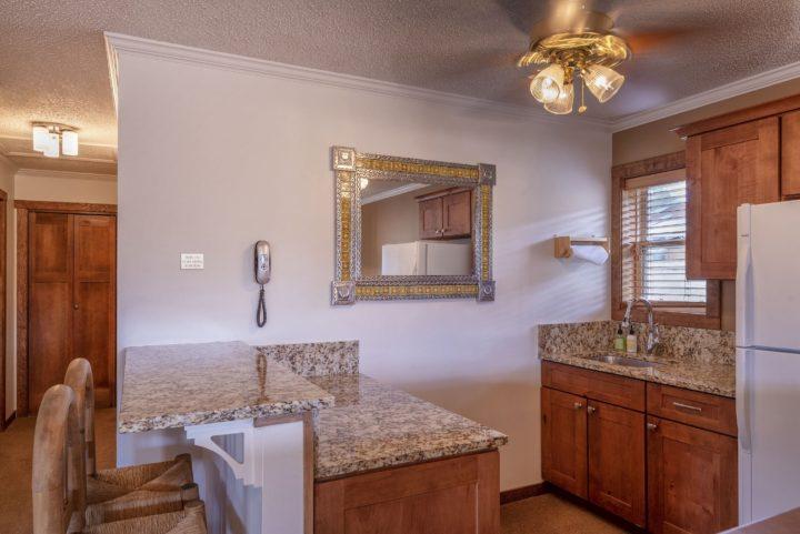 Upper living room has a third half kitchen/snack bar (3rd refrigerator).