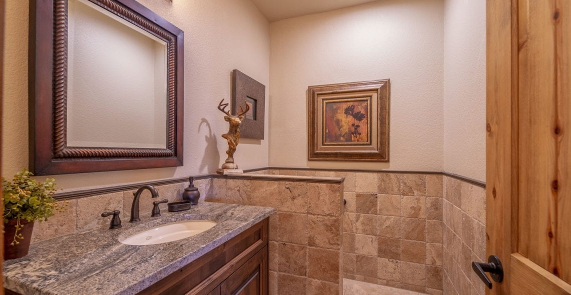 Half bath serves those in the Game Room. Also convenient as hot tub dressing area.