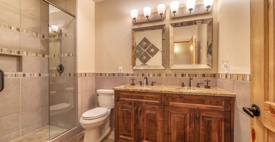 Hall bath shared by Bedroom 4 and Bedroom 5. Double sinks & glass walk-in shower.