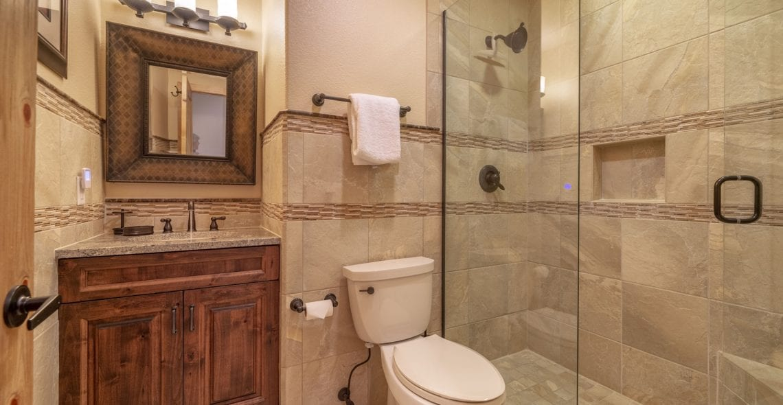 Private bath for Bedroom 2. Glass walk-in shower.