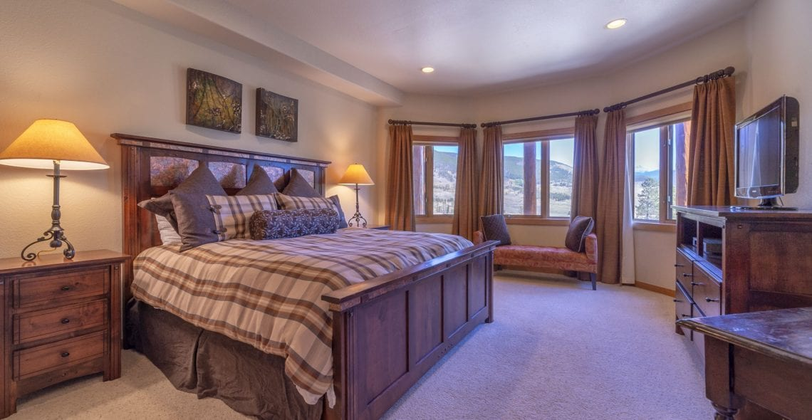 Bedroom 3--King bed, 5th TV, private bath, and bay windows with mile-wide views.