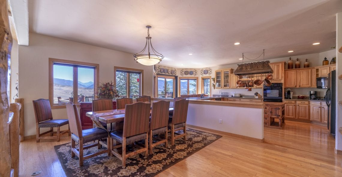 Dining area and kitchen on split level above living room.
