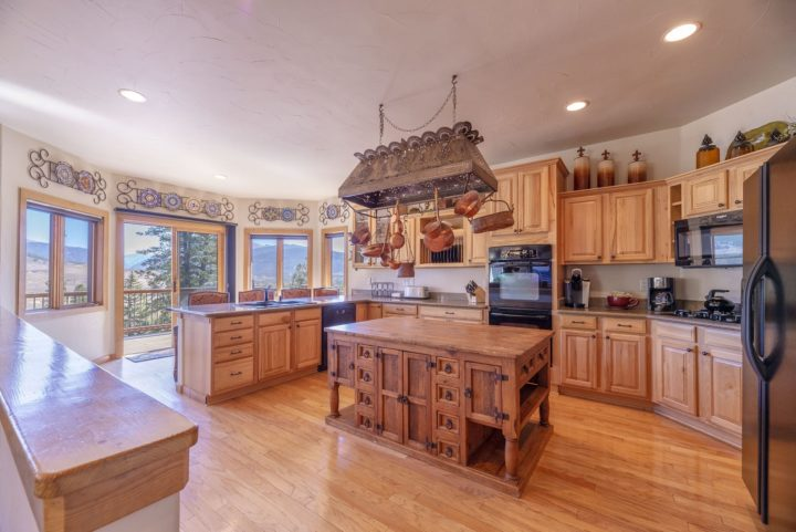 Gourmet kitchen with 20' of counter space and oversize butcher block work area.