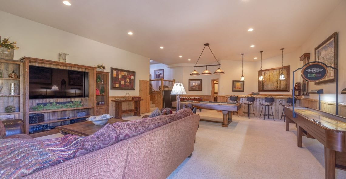 "Huge GAME ROOM with 75"" flat screen TV and lots of amenities."