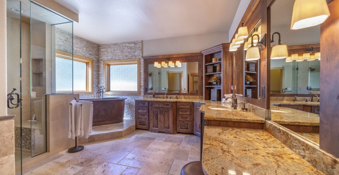Master Bath--glass walk-in shower, copper soaking tub, 2 sinks, granite counters