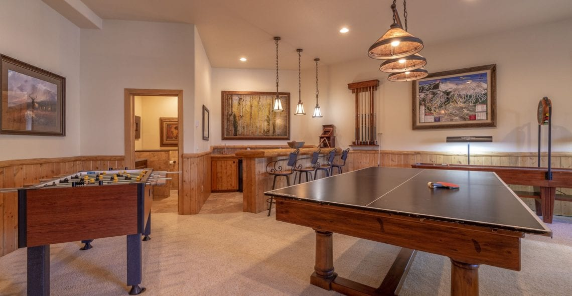 Pool table easily converts to ping pong table.