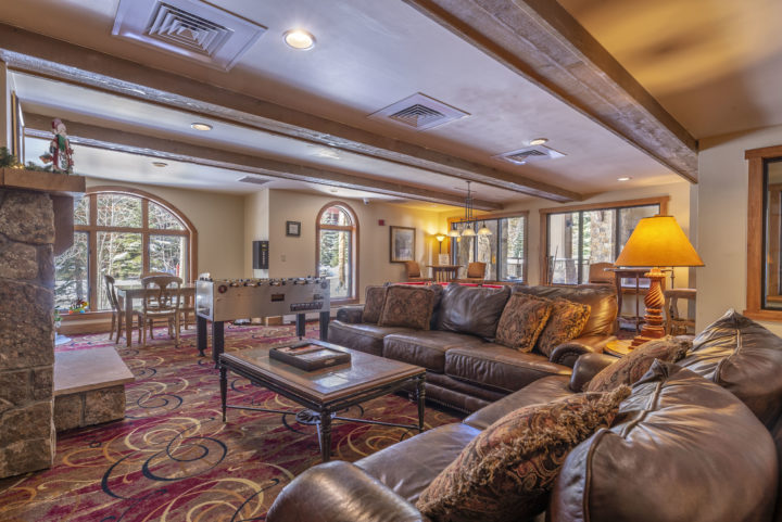 Red Hawk lobby lounge area with big screen TV and stone fireplace