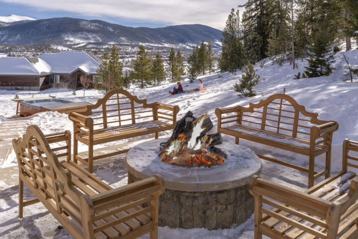 New fire pit area overlooking 12 person hot tub and sledding hill.
