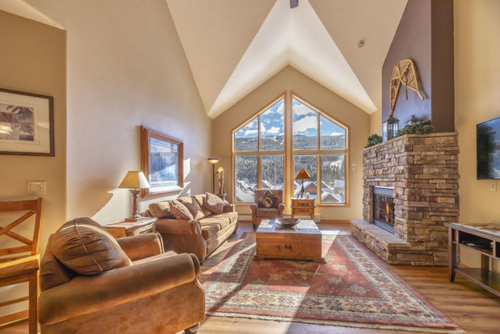 Two-story windows framing the ski runs (mile-wide view)