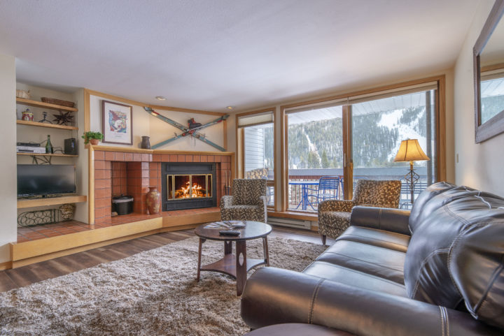 Living Room 1 in unit--fireplace, private deck, ski run view, TV1, Queen foldout