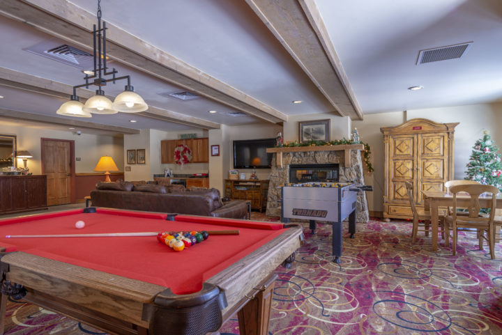 Building Game Room/Lobby area (pool table; lounge area facing big flat screen TV and stone fireplace)