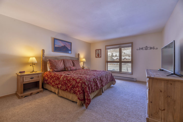 Bedroom 1 (King bed; 2nd flat screen TV; master bath; located on 1st level of unit)