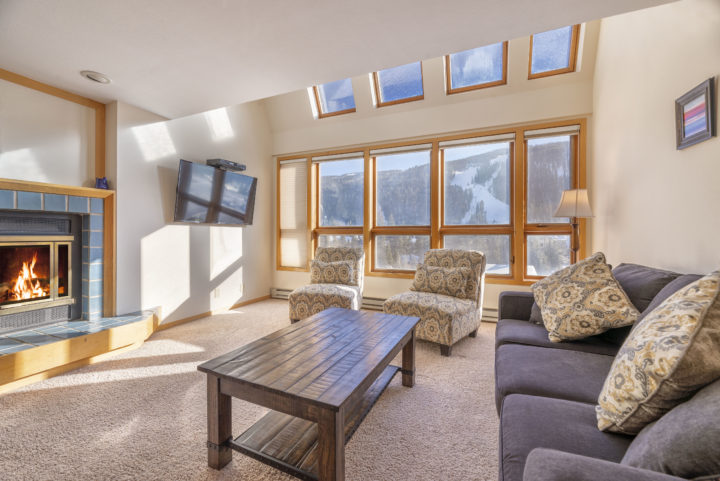 Living Room 2 (Upper level). Wall-to-wall windows facing ski runs