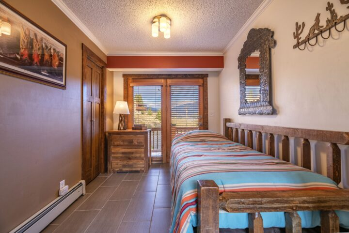 Bedroom 5 (Middle level)--Twin bed + Twin trundle bed (on rollers); hall bath; private entrance to deck.