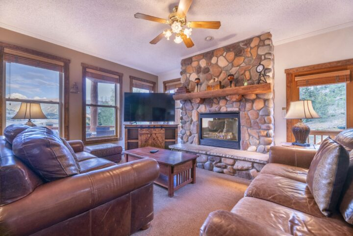 Main Living Room (Middle level of 3 floors). TV1 and stone fireplace.