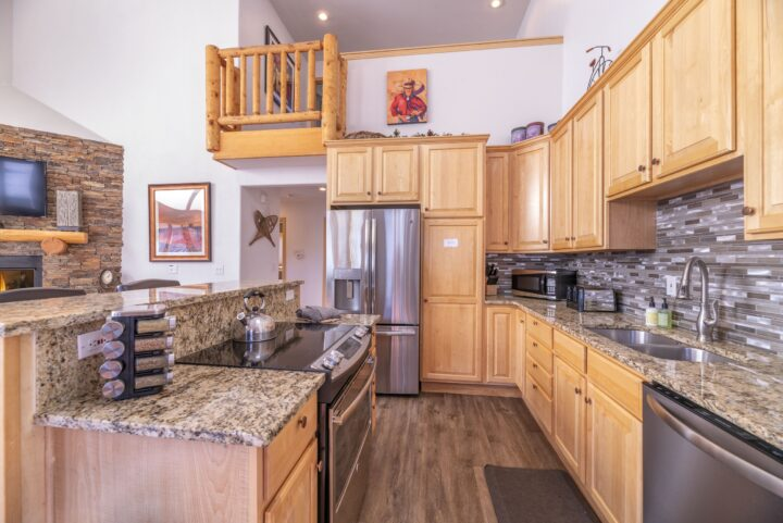 New appliances and granite counters in kitchen of Unit 190
