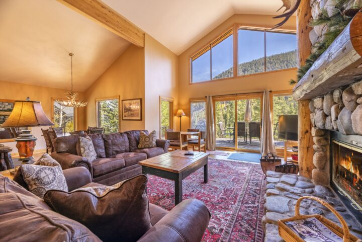 Living room opens onto a large elevated deck overlooking the mountains & river.
