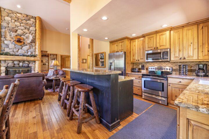 Gourmet kitchen--stainless steel appliances, granite counters, & alder cabinets.
