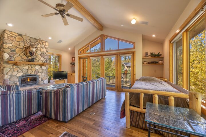 Family Room (2nd living area with stone fireplace, vaulted ceiling, TV/DVD area, Queen fold-out,, 2 Twin beds, and private bath)