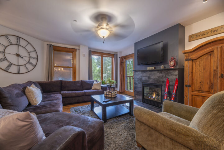 Living room--sectional sofa (Queen fold-out), fireplace, TV, DVD, private deck.